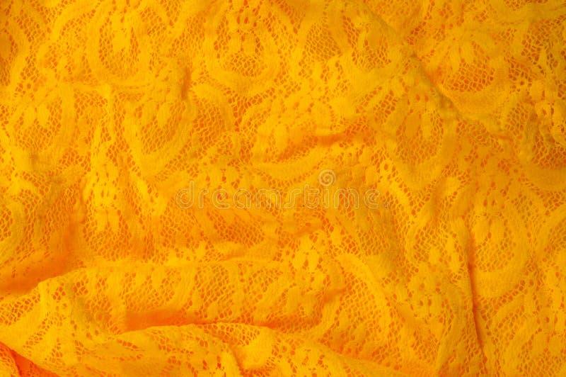 Beschaffenheit, Gewebe, Hintergrund Lacy Yellow-Gewebe, Spitze Ein dünnes OP lizenzfreie stockfotos