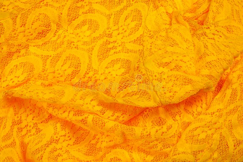 Beschaffenheit, Gewebe, Hintergrund Lacy Yellow-Gewebe, Spitze Ein dünnes OP lizenzfreie stockfotografie