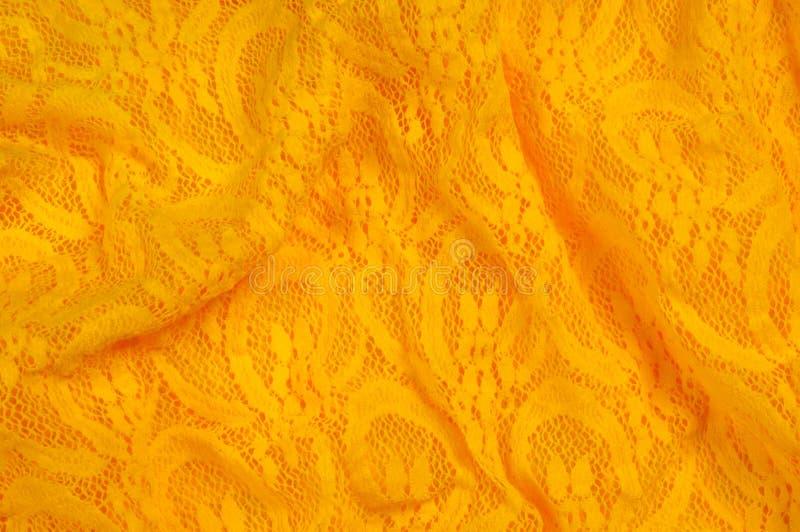 Beschaffenheit, Gewebe, Hintergrund Lacy Yellow-Gewebe, Spitze Ein dünnes OP lizenzfreies stockfoto
