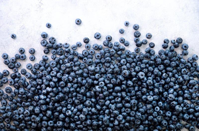 Beschaffenheit von Blaubeerbeeren schließen oben Grenzdesign Neuer Blaubeerhintergrund mit Kopienraum für Ihren Text vegan stockbilder