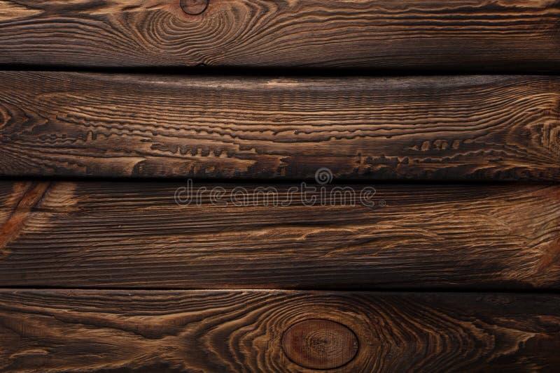 Beschaffenheit von Brettern des dunklen alten braunen Holzes lizenzfreie stockfotografie
