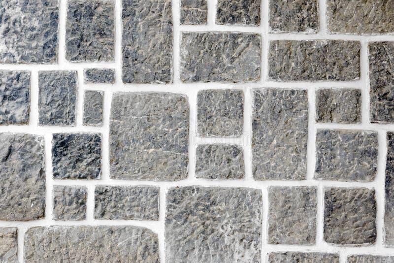Beschaffenheiten auf einer Granitwand lizenzfreie stockfotos