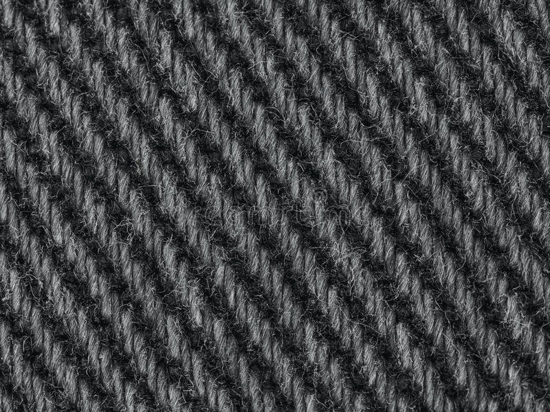 BESCHAFFENHEITS-Hintergrundrüttler der schwarzen Denimjeansgewebenahaufnahme Makro stockfotos