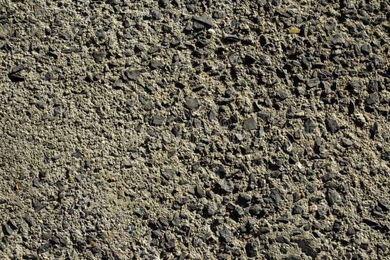 Beschaffenheitshintergrund der harten Oberfläche des Schattens der grauen Zement- und Steinpflasterungsstraße rieb unter Sonnenli stockbilder