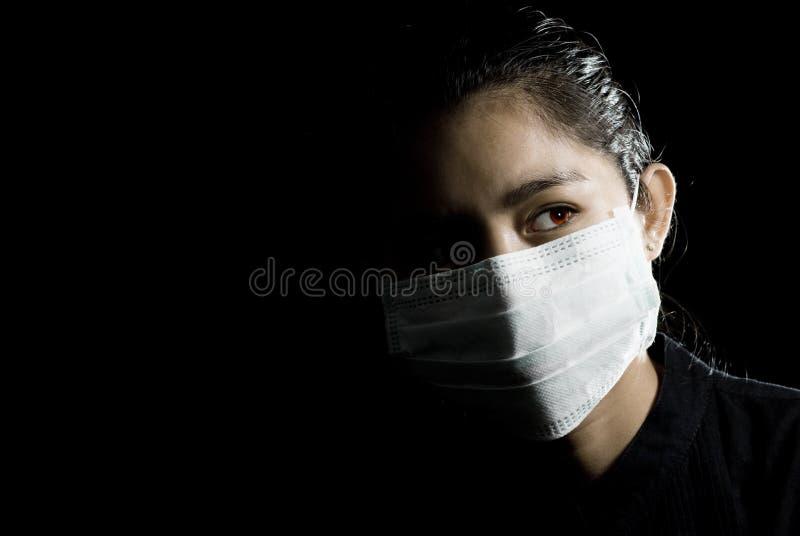 Beschermend gezichtsmasker op Aziatische vrouw royalty-vrije stock afbeeldingen