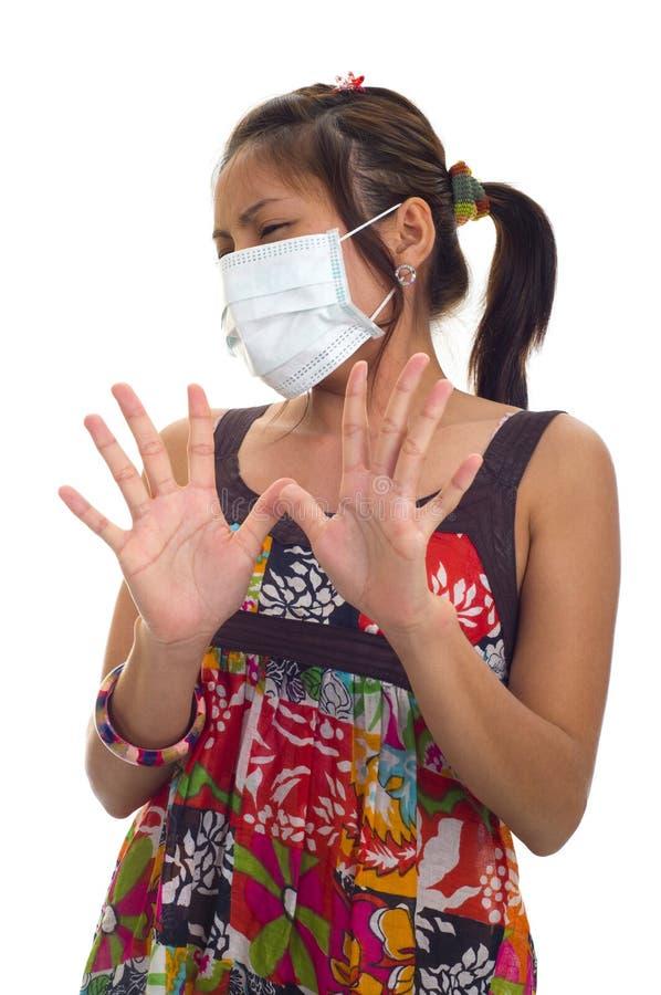 Beschermend masker op jonge Aziaat royalty-vrije stock afbeelding