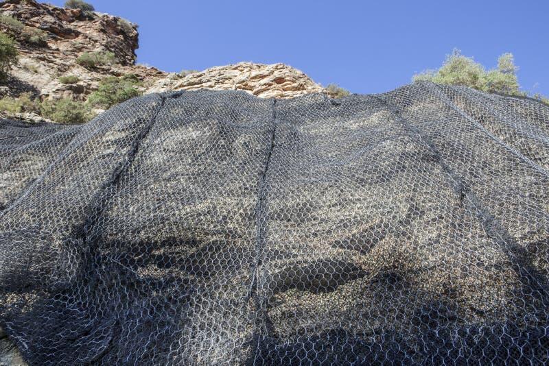 Beschermende netwerk van het berg het helling versterkte metaal, Spanje stock afbeelding
