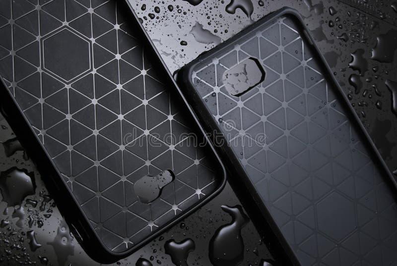 Beschermende smartphonegevallen stock afbeeldingen