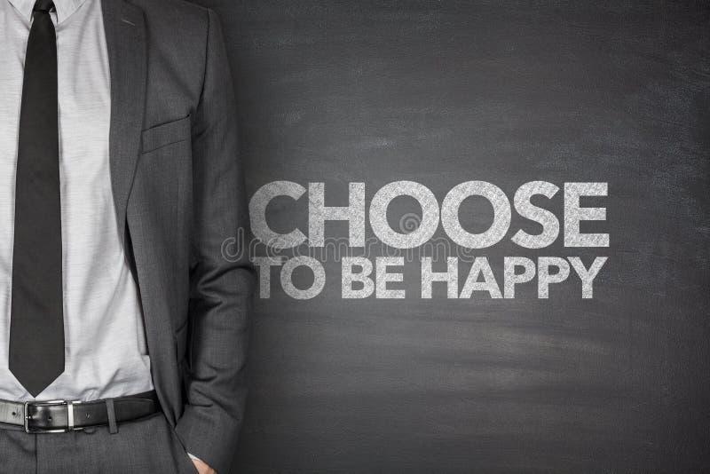 Beschließen Sie, auf Tafel glücklich zu sein stockbild