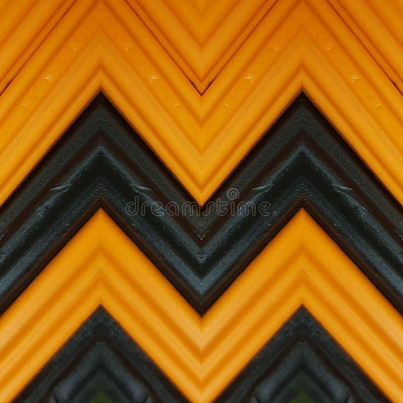 beschriften Sie m mit Stücken Plasticinestangen in den orange und schwarzen Farben, im Hintergrund und in der Beschaffenheit lizenzfreies stockfoto