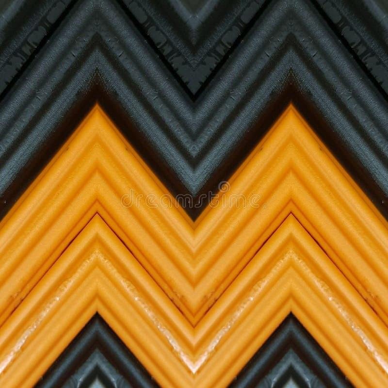 beschriften Sie m mit Stücken Plasticinestangen in den orange und schwarzen Farben, im Hintergrund und in der Beschaffenheit stockfoto