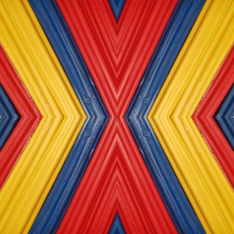 beschriften Sie x mit Stücken Plasticinestangen in den Farben sich gelb färben, blau und rot, Hintergrund und Beschaffenheit lizenzfreie stockfotos