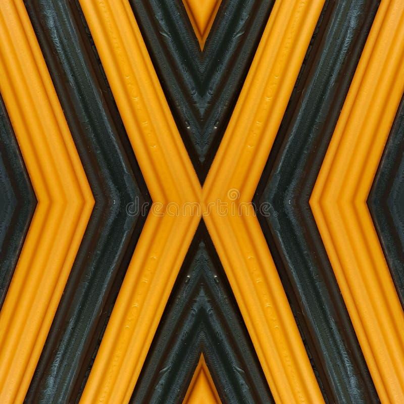 beschriften Sie x mit Stücken Plasticinestangen in den orange und schwarzen Farben, im Hintergrund und in der Beschaffenheit stockbild