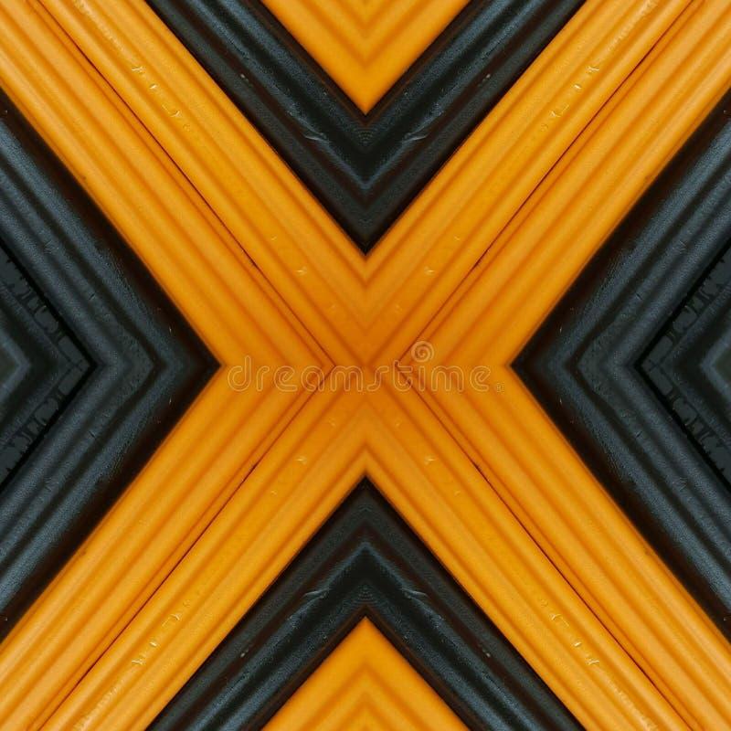 beschriften Sie x mit Stücken Plasticinestangen in den orange und schwarzen Farben, im Hintergrund und in der Beschaffenheit stockfotografie