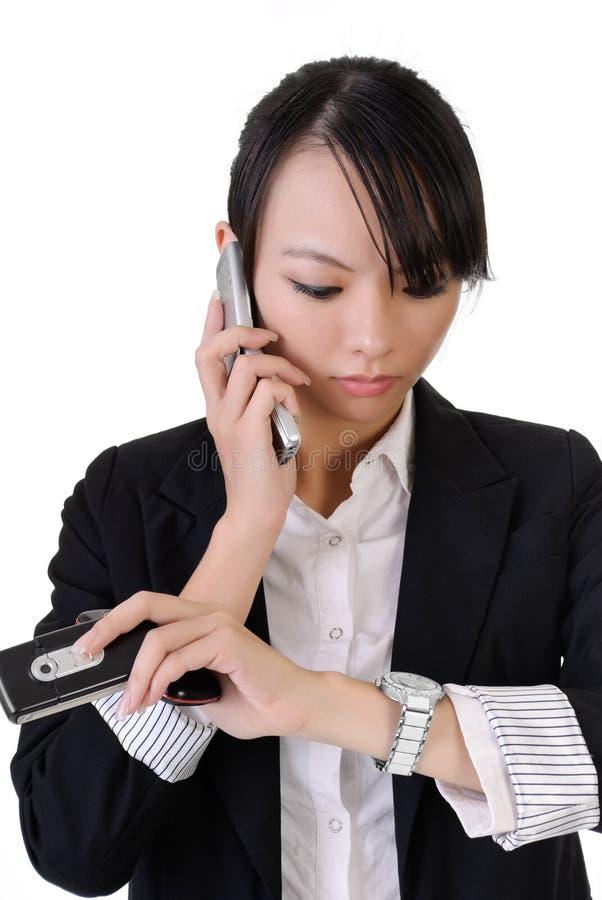 Besetzte Geschäftsfrau lizenzfreie stockbilder