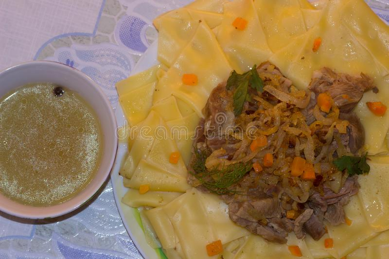 Beshbarmak - traditional dish in Central Asia stock photos