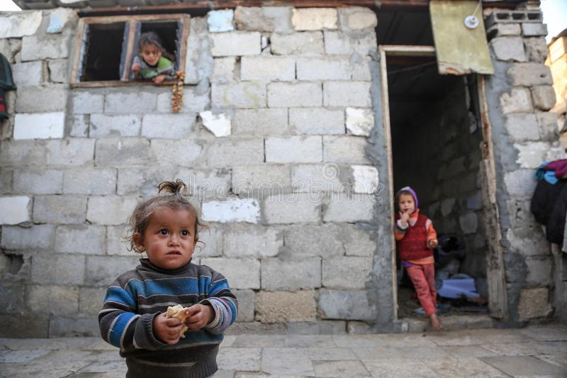 In besieged Gaza, poverty exacerbates child malnutrition stock photo
