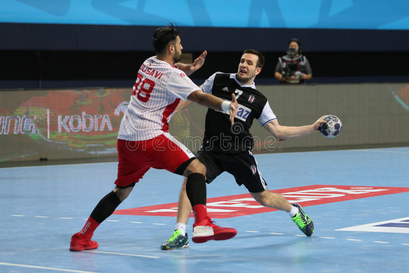 Besiktas MOGAZ HT and Dinamo Bucuresti Handball Match. KOCAELI, TURKEY - FEBRUARY 11, 2017: Players in action during VELUX EHF Champions League handball match royalty free stock photo