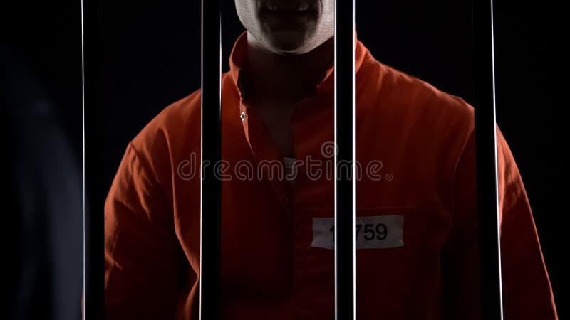 Beslagit mördareanseende mot fängelsestänger som fängslas för att kidnappa fotografering för bildbyråer