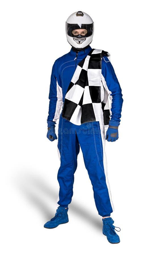 Beslutsam racerbilsförare i störthjälm för säkerhet för blåa vita total- skohandskar för motorsport väsentlig och rutig rutig fla arkivbild