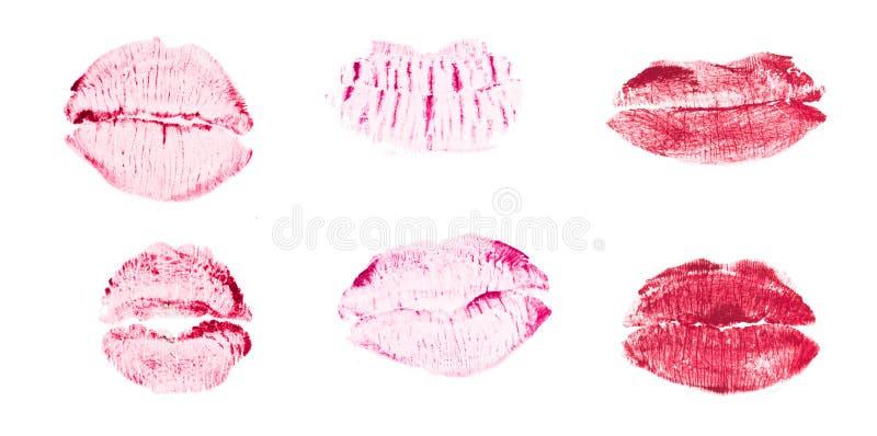 Beso del l?piz labial aislado en el fondo blanco imagenes de archivo