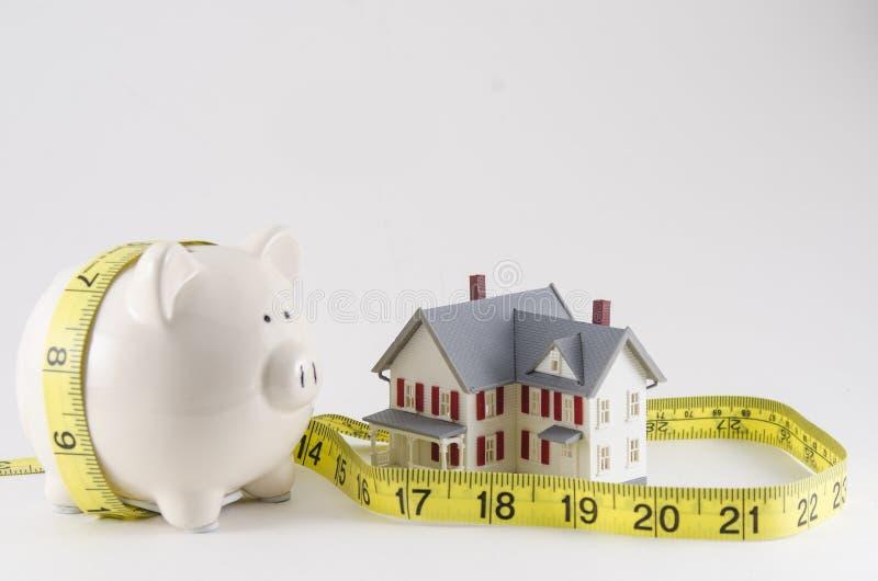 Besparingen op een huishoudenbegroting stock afbeelding