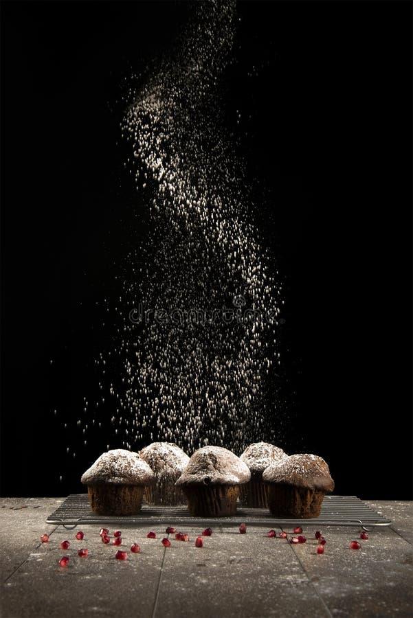 Besprühen von Muffins lizenzfreies stockbild