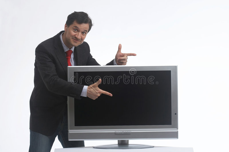 It is the best. Salesman presenting a Plasma-TV stock images