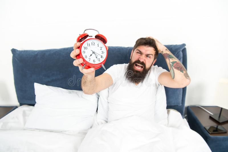 Best alarm clocks for people who hate mornings. Man bearded hipster hate wake up early. Destructive energy. Hardest. Moment of day. It is totally normal to hate stock photography
