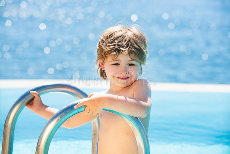 Best Beaches in the World. Concept about party and music. Baby boy in the pool. Holidays and vacations. Happy vacation royalty free stock images