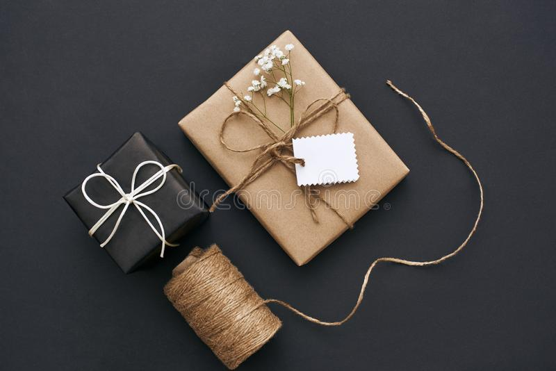 Best birthday. Design your own gift box with kraft paper, ribbon and scissors. Best birthday. Gift box with kraft paper, ribbon and scissors on dark background royalty free stock photo