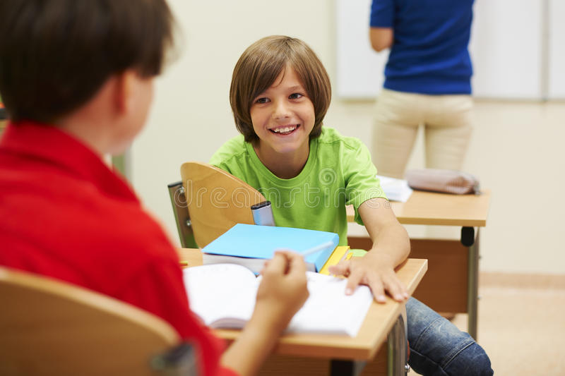 Best buddies in the classroom royalty free stock photos