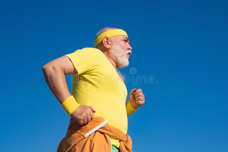 Best cardio workout. The old and young sportsmen running on the road. Portrait of healthy senior sport man. Summer and. Active holidays royalty free stock photo