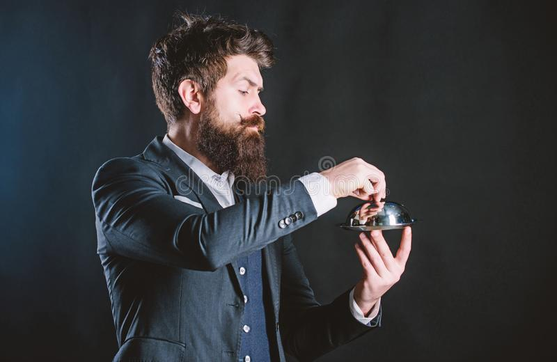Best chef ever. Mature hipster with beard hold food tray in restaurant. brutal caucasian hipster hold metallic dish stock image