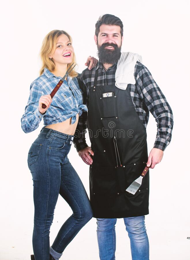 Best chef ever. Picnic barbecue. food cooking recipe. Man bearded hipster and girl. Preparation and culinary. Tools for. Roasting meat. Couple in love hold royalty free stock images