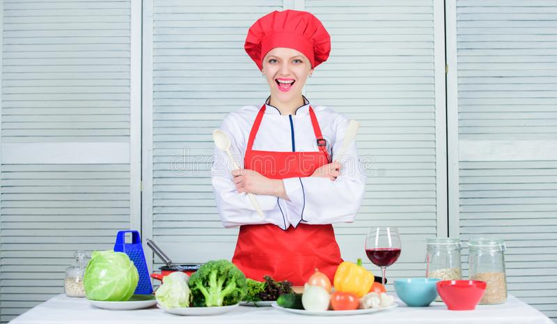 Best culinary recipes to try at home. Lady adorable chef teach culinary arts. Professional culinary tips. Culinary show. Concept. Woman pretty chef wear hat and stock photo