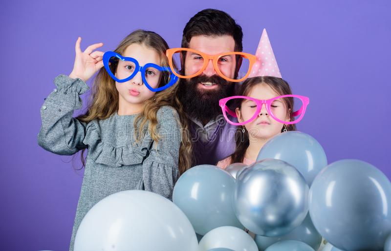 Best dad ever. Fathers day. Daughters need father actively interested in life. Birthday party. Father with two daughters. Having fun. Fatherhood concept stock photo