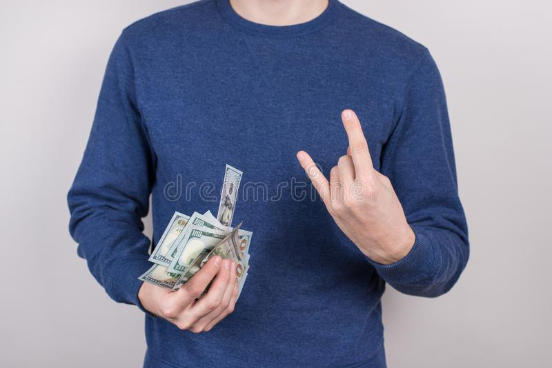 Best day ever concept. Cropped closeup studio photo shot of satisfied mad emotional harsh brutal business businessman holding many. Much money in hand isolated royalty free stock photo