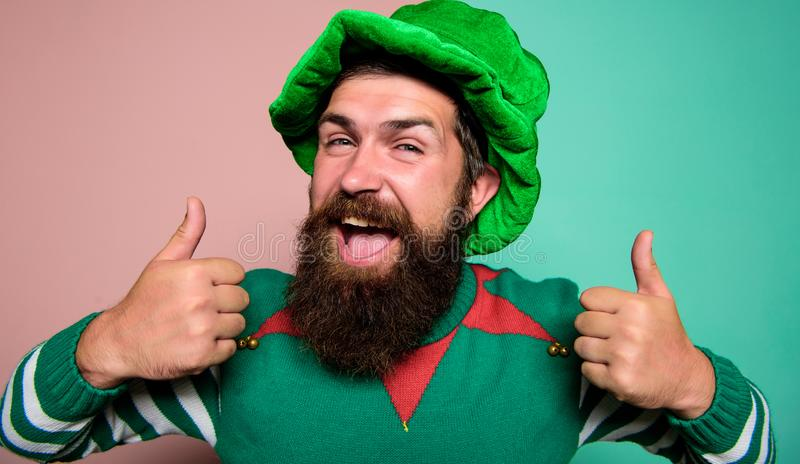 Best day ever. St Patricks day. Hipster with beard wearing green party costume thumbs up. Cheerful man celebrate holiday stock image