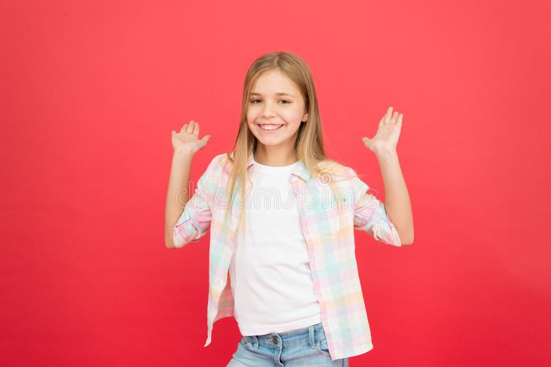 Best day ever. stylish beauty. small girl red background. happy childhood. smiling blonde kid. child girl with long royalty free stock photo