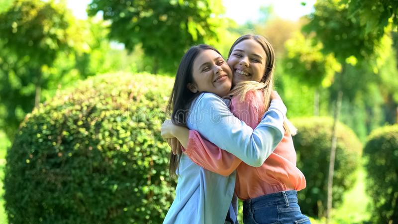 Best female friends hugging outdoors, happy to see each other, sisters relations royalty free stock images
