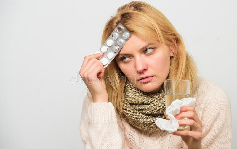 Best fever reducer. Girl suffer headache and take medicine. Headache and fever remedies. Woman tousled hair scarf hold. Tablets blister. Guidelines for treating royalty free stock photos
