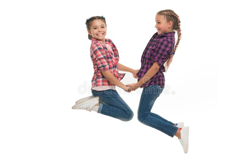 Best friend dressing. Girls friends wear similar outfits have same hairstyle kanekalon braids white background. Sisters. Family look outfit. Dress similar with royalty free stock photo
