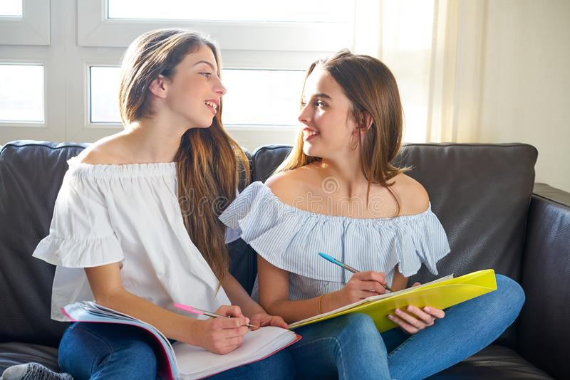 Best friend girls studying homework at home stock photo