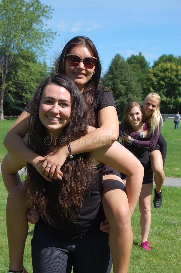 Best Friend Piggy-Back. Friends giving each other piggy-backs royalty free stock images
