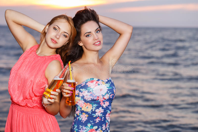 Best friends on the beach. Summer, sea. Cute girls on the beach royalty free stock image