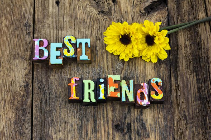 Best friends bff friendship support love together joy. Barnwood letters friend relationship adventure journey help kindness kind honest believe letterpress royalty free stock photos