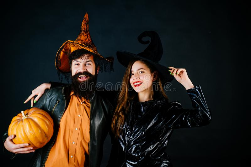 Best friends celebrated Halloween. Portrait of happy young couple in Halloween with pumpkin. Retro Halloween couple stock photos