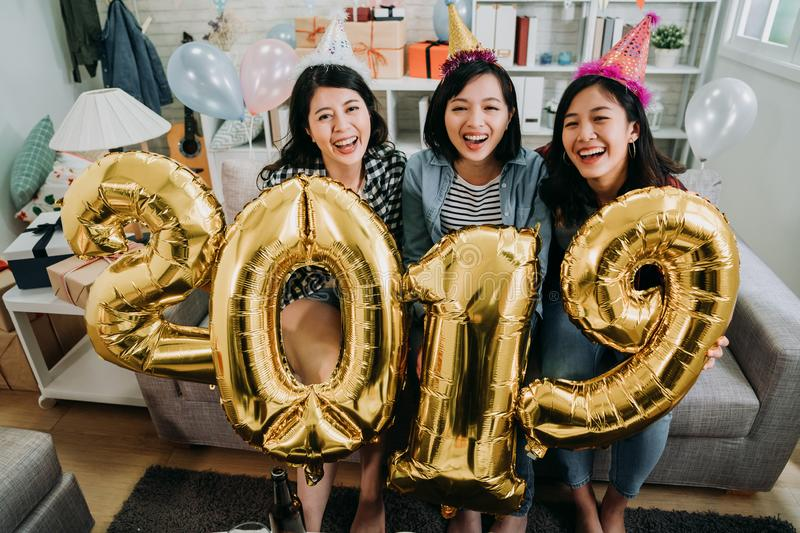 Best friends celebrating new year party indoor stock photography