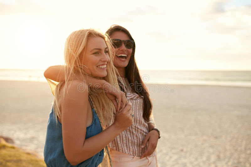 Best friends enjoying summer vacation on beach royalty free stock photography